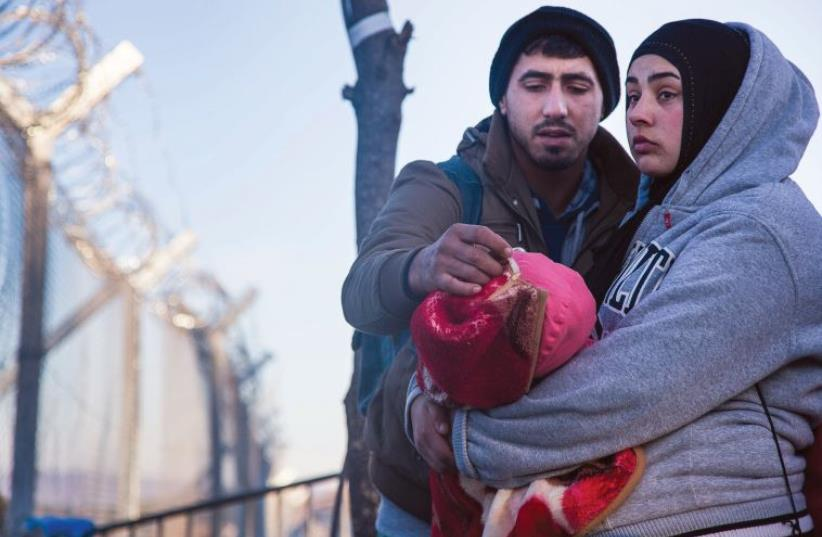Taken soon after this Syrian couple learned they would not be allowed to cross to Macedonia (photo credit: MERAV NAOR-WEINSTOCK)