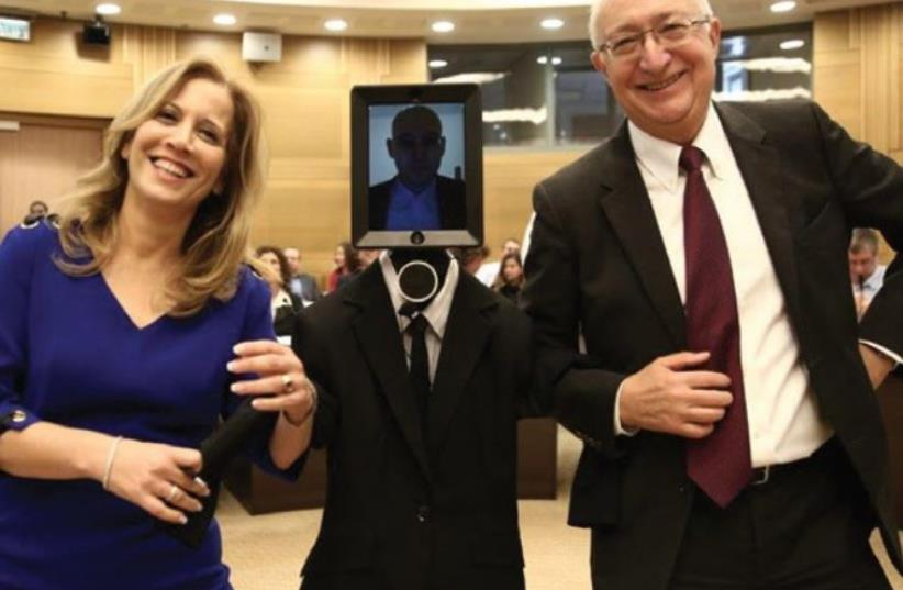 MK MANUEL TRACHTENBERG (right) and MK Aliza Lavie pose recently with futurologist Dr. Roey Tzezana, speaking from the US via a telepresence robot (photo credit: KNESSET)