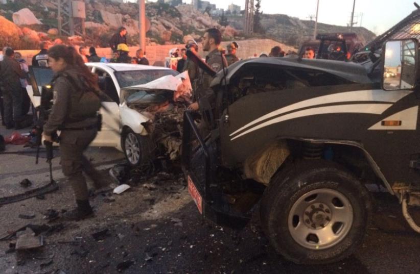 Scene of car-ramming attack near Ma'aleh Adumin, February 13, 2016. (photo credit: ARIK ABULOF/JERUSALEM FIRE AND RESCUE)