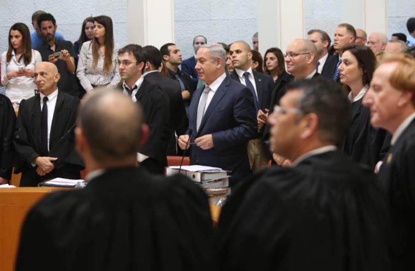Prime Minister Benjamin Netanyahu addresses the High Court on the gas deal (photo credit: GIL YOCHANAN/POOL)