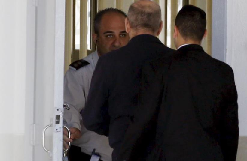 Former prime minister Ehud Olmert (C) enters Ma'asiyahu prison near Ramle (photo credit: REUTERS)