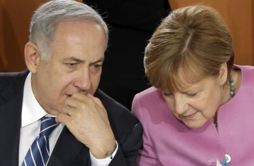 German Chancellor Angela Merkel and Israeli Prime Minister Benjamin Netanyahu speak before a lunch as part of a one day governmental meeting at the Chancellery in Berlin, Germany, February 16, 2016 (photo credit: REUTERS)