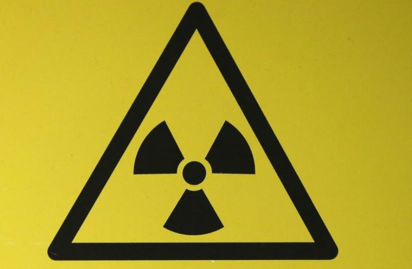 A radioactive material hazard symbol, called a trefoil, (photo credit: REUTERS)