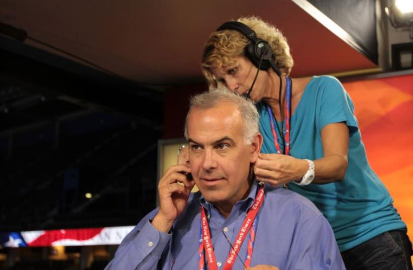 David Brooks and PBS staff at rehearsal for PBS Newshour in 2012 (photo credit: PBS NEWSHOUR/WIKIMEDIA COMMONS)