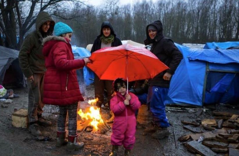 IsraAid volunteers help refugees in Northern France. (photo credit: Courtesy)