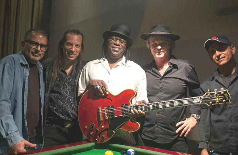 AMERICAN BLUES guitarist Joe Louis Walker (center) with Tel Aviv-based Blues Rebels (photo credit: VICTOR M.)