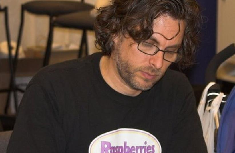 hotograph of author Michael Chabon at a book signing at WonderCon in 2006. (photo credit: CHARLIE REIMAN/WIKIMEDIA COMMONS)