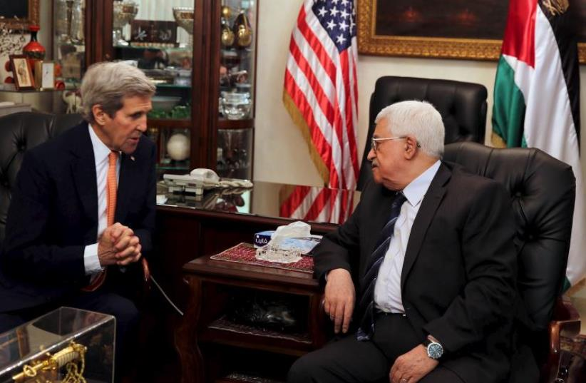Palestinian President Mahmoud Abbas meets with U.S. Secretary of State John Kerry at Abbas' residence in Amman, Jordan February 21, 2016 (photo credit: REUTERS)