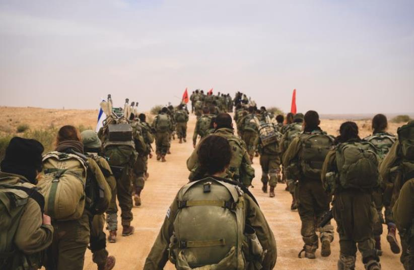 Soldiers from the co-ed Caracal Battalion complete their rigorous eight months of training to receive their beret (photo credit: IDF SPOKESPERSON'S UNIT)