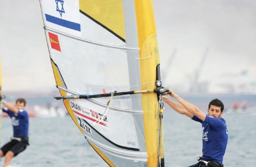 Shahar Zubari won the first race of the 2016 RS:X windsurfing World Championships in Eilat yesterday, getting the event off to an ideal start for host Israel. (photo credit: AMIT SHISEL/ISA)