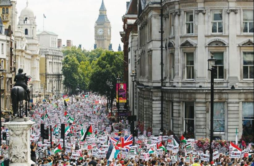 Demonstrators against 2014's Operation Protective Edge march up Whitehall in London (photo credit: REUTERS)