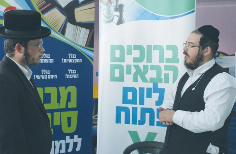 Man looks for work in Beit Shemesh (photo credit: SAM SOKOL)