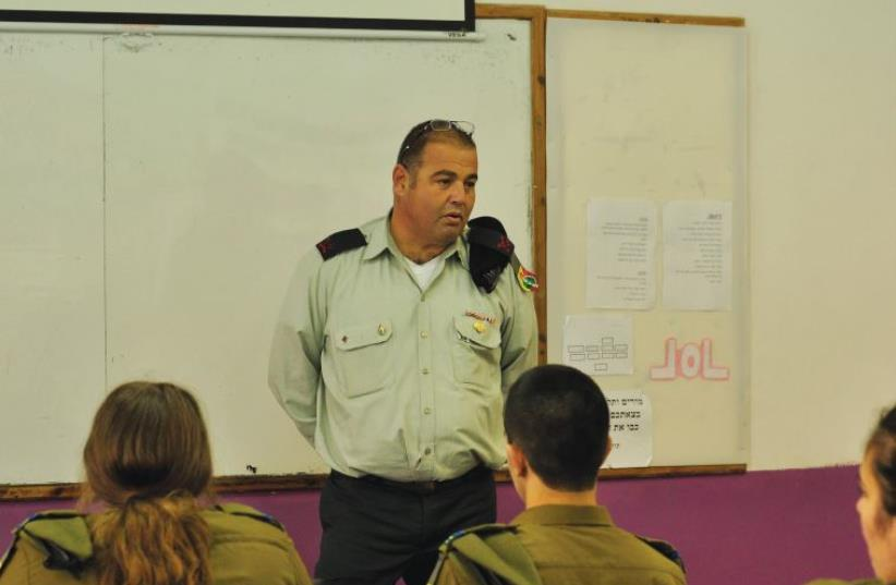 CHIEF TECHNOLOGY and Maintenance officer Brig.-Gen Eliezer Ben Harush addresses students at an army engineering training program in Afula. (photo credit: IDF SPOKESMAN'S UNIT)