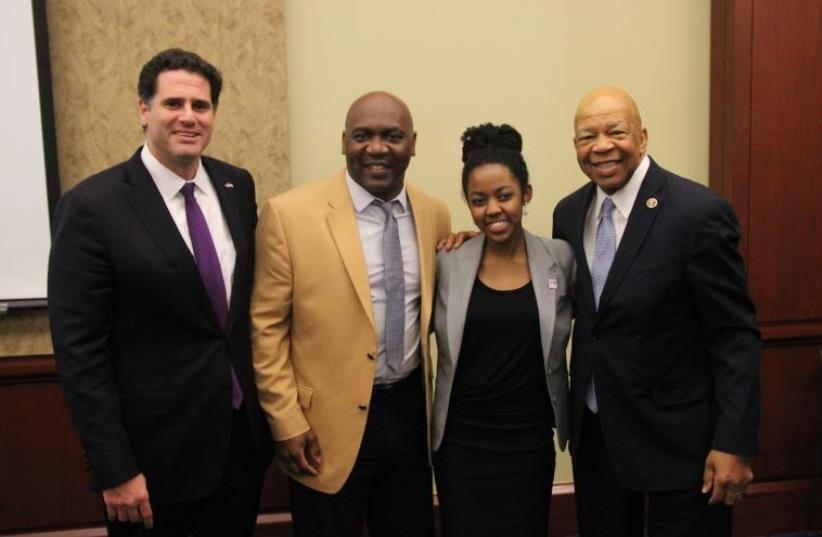 From left: Israel's envoy to the US, Ron Dermer, Congressman Elijah Cummings, former NFL player Thurman Thomas, and an unidentified woman (photo credit: Courtesy)