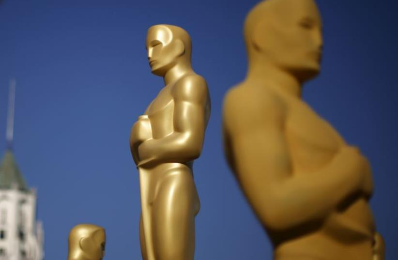 Oscar statues are painted outside the entrance to the Dolby Theatre  (photo credit: REUTERS)