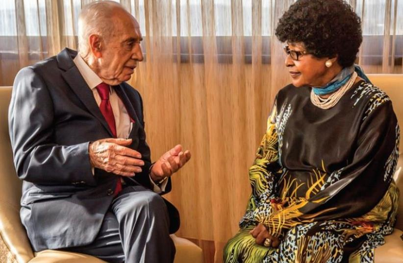 Former president Shimon Peres meets with former South African first lady Winnie Madikizela-Mandela in Johannesburg, February 28, 2016 (photo credit: SHIMON PERES SPOKESMAN)