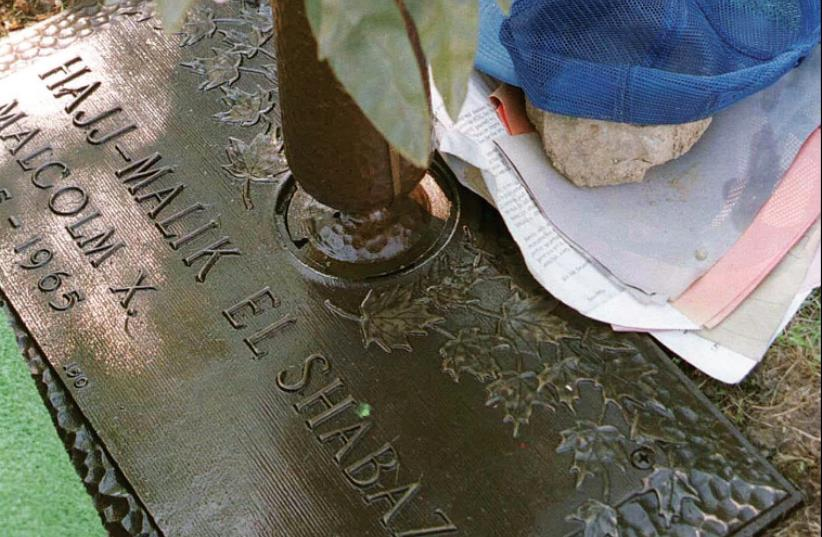 THE GRAVE of civil rights leader Malcolm X at Ferncliff Cemetery in Ardsley, New York. (photo credit: REUTERS)
