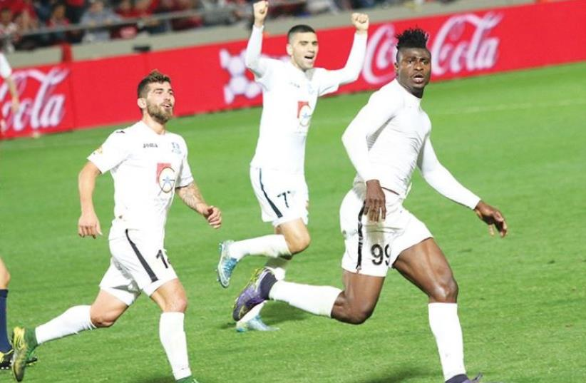 Hapoel Acre striker Lanry Kahinda (right) celebrates after scoring his second goal in last night's 2-0 win over Hapoel Tel Aviv at Bloomfield Stadium. (photo credit: ADI AVISHAI)