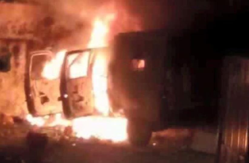 Military vehicle on fire in massive Kalandiya riot (photo credit: Courtesy)