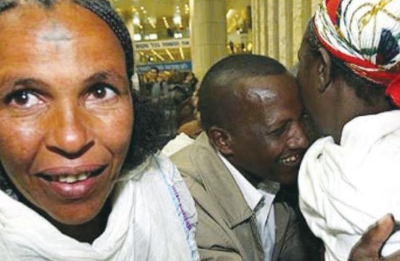 Ethiopian immigrants greet family members in 2010 (photo credit: BRIAN HENDLER)