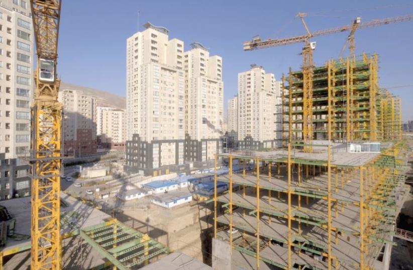 A VIEW shows buildings under construction in Tehran in January. Iran has deep economic problems. (photo credit: REUTERS)