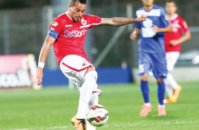 Hapoel Beersheba midfielder Maor Buzaglo attempts a shot (photo credit: DANNY MARON)