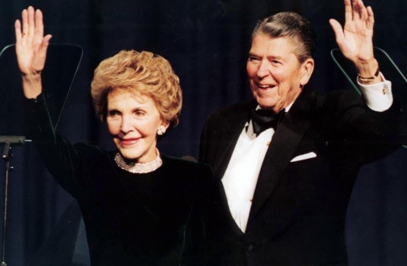 President Ronald Reagan and his wife Nancy wave while attending a gala celebrating his 83rd birthday, February 3, 1994 in Washington (photo credit: REUTERS)