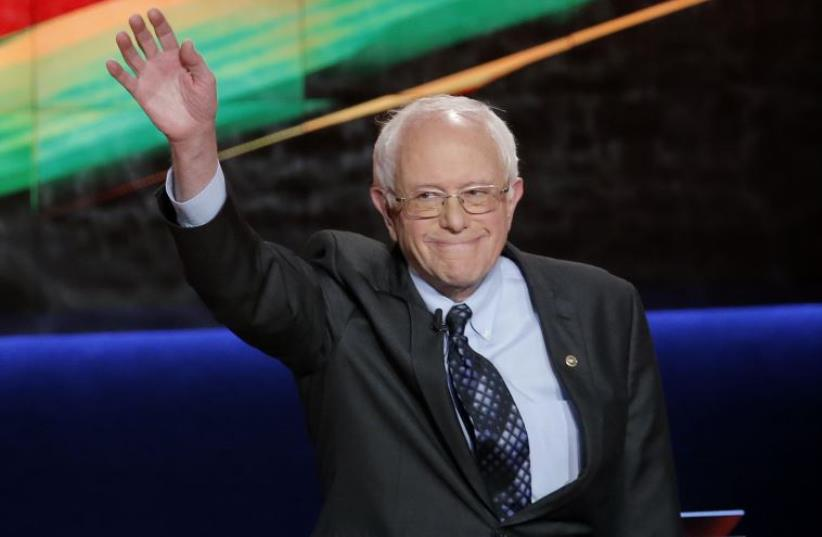 Democratic US presidential candidate and U.S. Senator Bernie Sanders waves at the start of the Democratic U.S. presidential candidates' debate in Flint, Michigan, March 6, 2016 (photo credit: REUTERS)