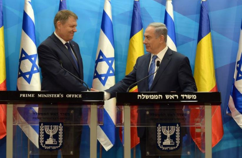 Netanyahu with Romanian President Klaus Werner Lohannis (photo credit: CHAIM TZACH/GPO)