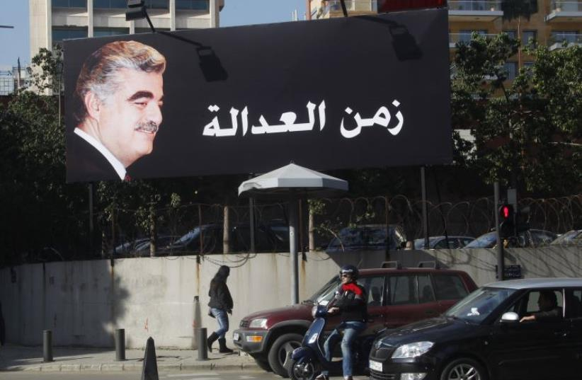A billboard of former Prime Minister Rafik al-Hariri is displayed along a street in Beirut (photo credit: REUTERS)