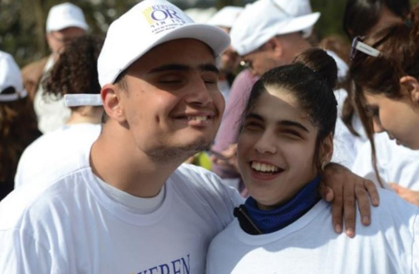 PREAL DAABAH (right) joins with Or Chaim at last year's Jerusalem Marathon (photo credit: Courtesy)