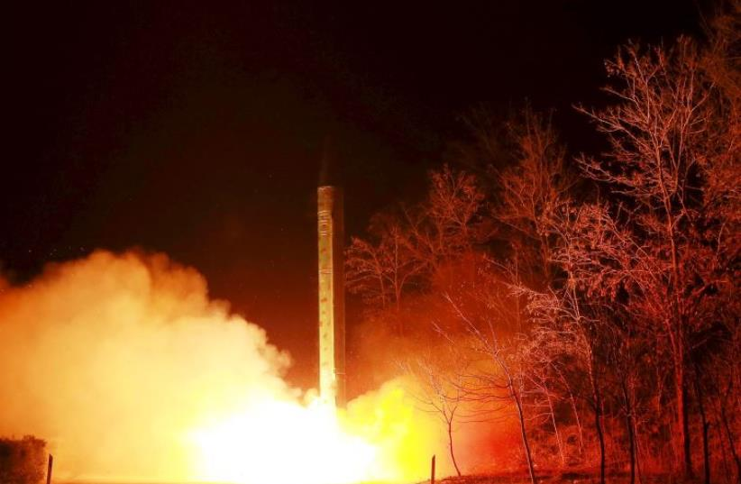A ballistic rocket launch drill of the Strategic Force of the Korean People's Army (KPA) is seen at an unknown location, in this undated photo released by North Korea's Korean Central News Agency (KCNA) in Pyongyang on March 11, 2016. (photo credit: KNCA KNCA)