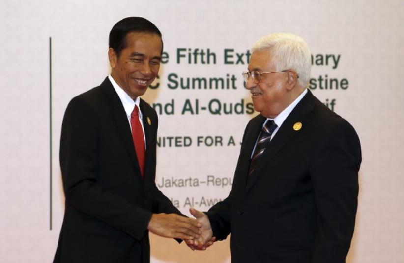 Indonesian President Joko Widodo (L) welcomes Palestinian President Mahmoud Abbas to the 5th Organization of Islamic Cooperation (OIC) Summit on Palestinian issues in Jakarta (photo credit: REUTERS)