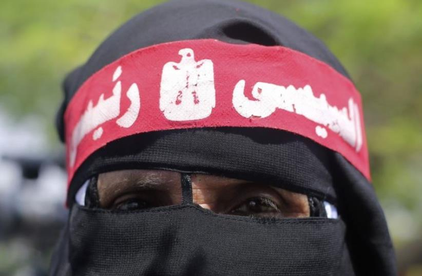"""A supporter of of Egypt's new President Abdel Fattah al-Sisi wears a full veil (niqab) with a headband that reads """"al-Sisi my president"""" (photo credit: REUTERS)"""