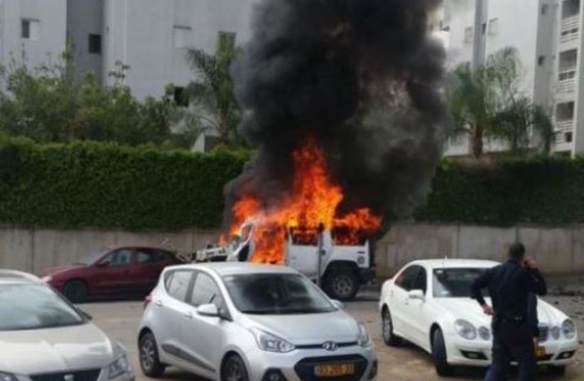 Scene of car bomb in Tel Aviv (photo credit: POLICE SPOKESPERSON'S UNIT)