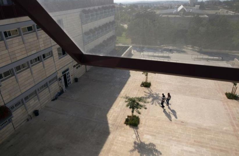 Students walk at the campus of the Ariel University Center in the West Bank Jewish settlement of Ariel (photo credit: REUTERS)