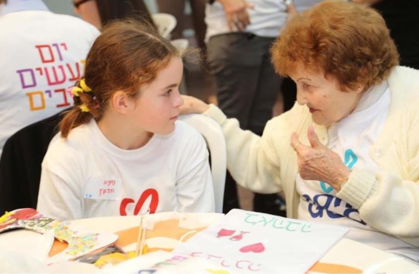 Volunteers giving back to the community on Good Deeds Day (photo credit: SIVAN FARAJ)
