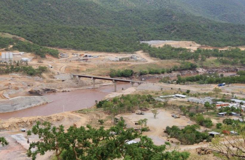 ETHIOPIA'S GREAT Renaissance Dam is constructed in Guba Woreda, some 40 km (25 miles) from Ethiopia's border with Sudan in 2013. (photo credit: REUTERS)