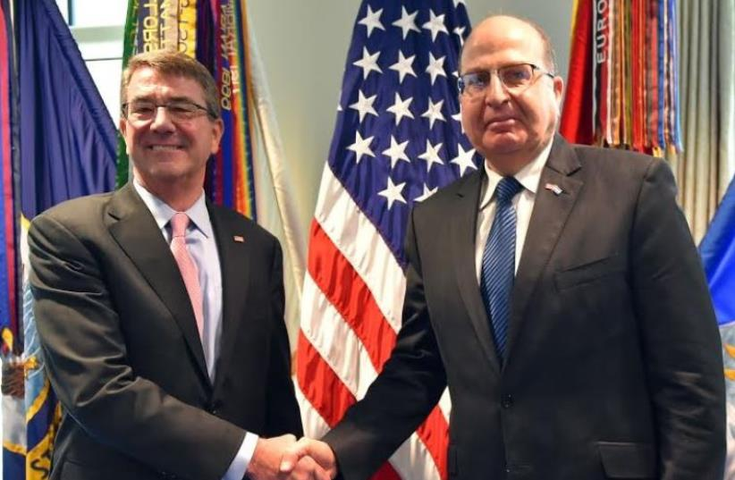 US Secretary of Defense Ash Carter (left) and Israel Defense Minister Moshe Ya'alon (right) (photo credit: ARIEL HERMONI / DEFENSE MINISTRY)