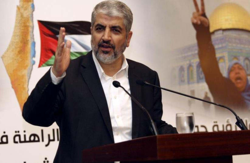 Hamas leader Khaled Meshaal speaks during a news conference in Doha, Qatar (photo credit: REUTERS)