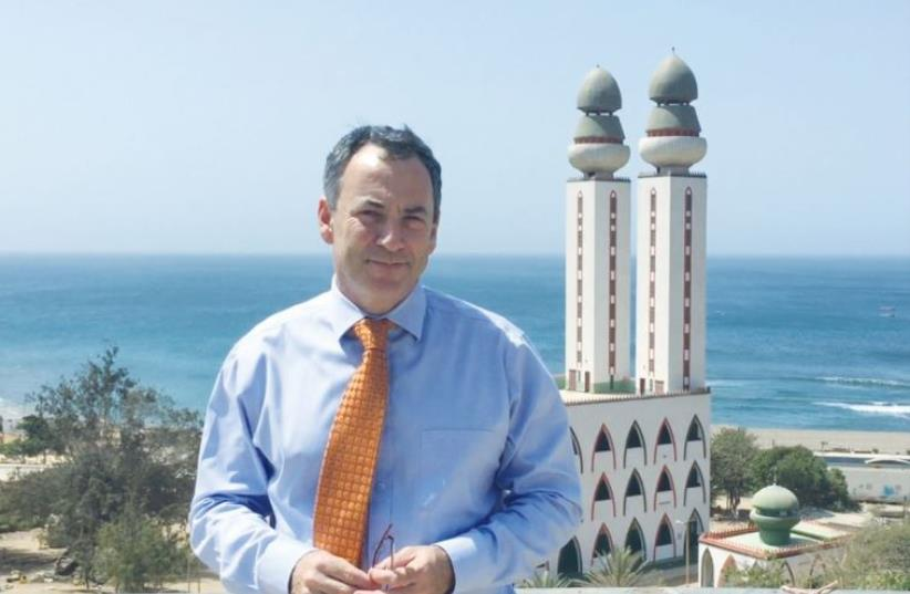 ISRAEL'S AMBASSADOR to Senegal, Paul Hirschson, is seen in front of the Divinity Mosque in Dakar (photo credit: SETH J. FRANTZMAN)