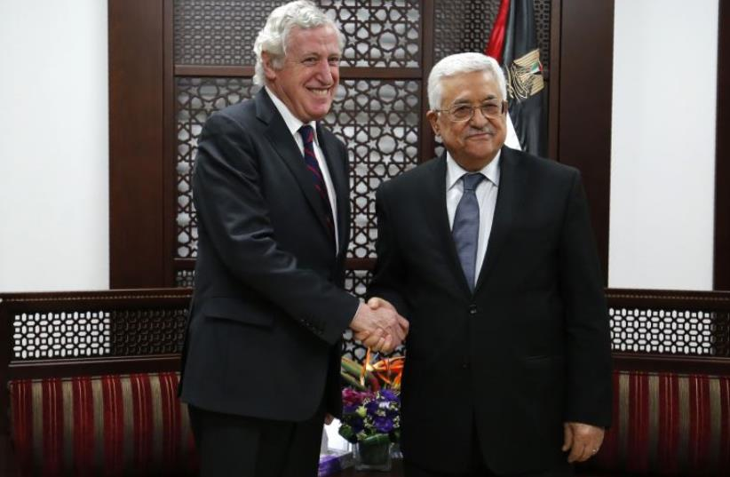 France's Middle East envoy Pierre Vimont (L) meets with Palestinian president Mahmud Abbas on March 15, 2016, in the West Bank city of Ramallah (photo credit: ABBAS MOMANI / AFP)