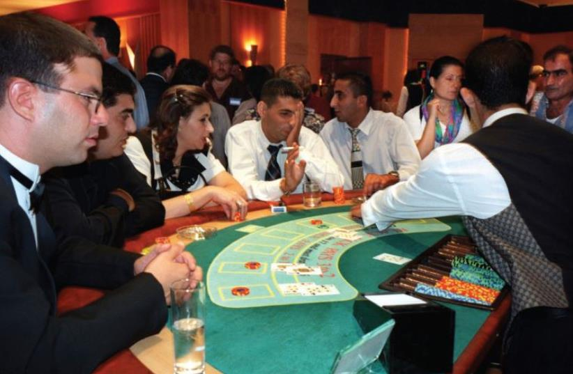 Israelis flock to the Oasis Casino in Jericho, West Bank, in September 1998 (photo credit: REUTERS)