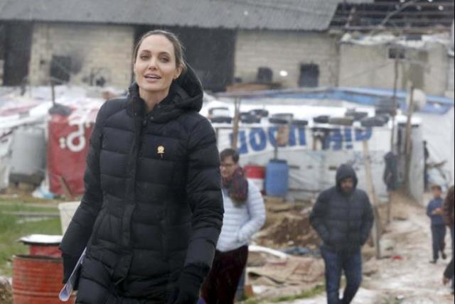 United Nations High Commissioner for Refugees (UNHCR) Special Envoy Angelina Jolie visits Syrian refugees in the Bekaa valley, Lebanon March 15, 2016. March 15 marks the 5th anniversary of peaceful protests against President Bashar al-Assad, leading to the devastating civil conflict in the country.  (photo credit: REUTERS)