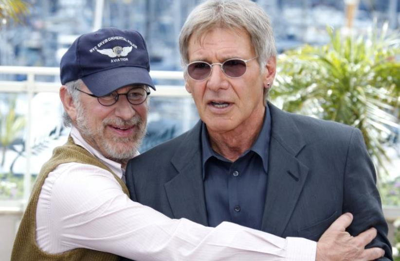 """US director Steven Spielberg (L) positions cast member Harrison Ford at a photocall for the film """"Indiana Jones and the Kingdom of the Crystal Skull"""" at the 61st Cannes Film Festival May 18, 2008. (photo credit: REUTERS)"""