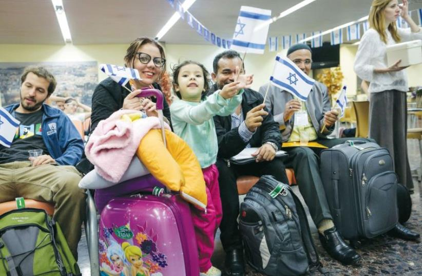 NEW IMMIGRANTS from Brazil arrive at Ben-Gurion International Airport on March 14. (photo credit: Courtesy)