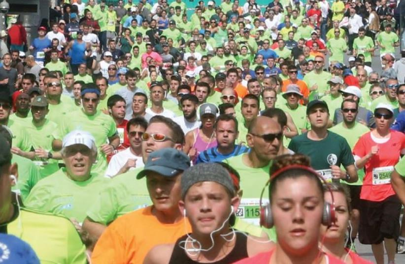 Runners participate in the fifth annual Jerusalem Marathon in 2015 (photo credit: MARC ISRAEL SELLEM)