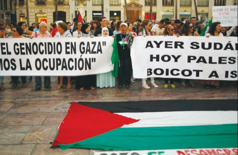The banners read: Stop the genocide in Gaza. Stop the occupation. Yesterday South Africa, today Palestine. Boycott Israel. Gaza bleeds (photo credit: REUTERS)