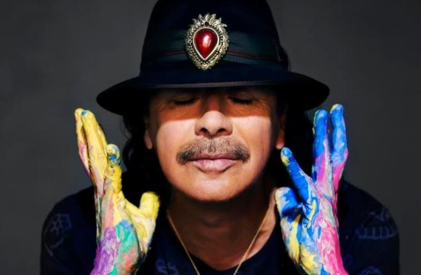 Carlos Santana (photo credit: Courtesy)