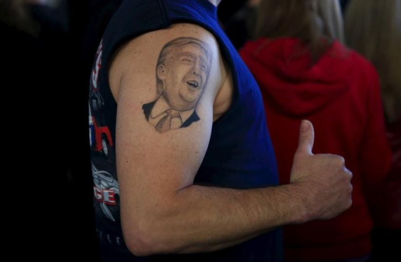 A supporter shows his tattoo before US Republican presidential candidate Donald Trump's campaign rally in Youngstown, Ohio (photo credit: REUTERS)